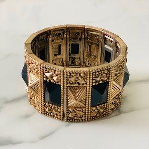 Gold bracelet with faux onyx inlays